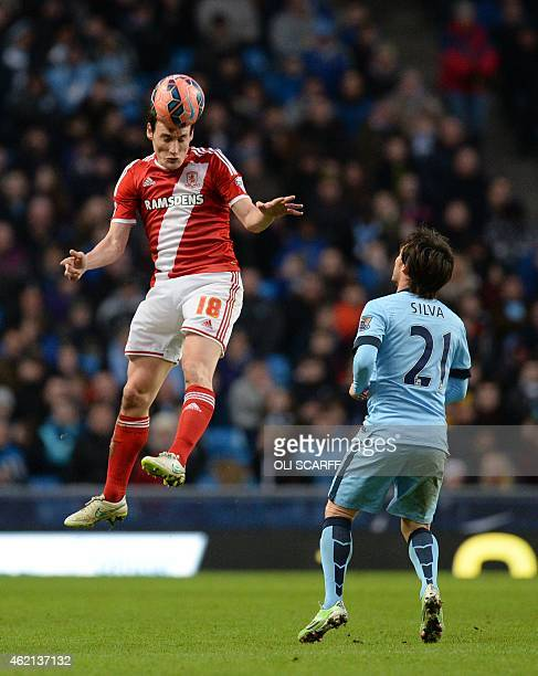 Middlesbrough's English midfielder Dean Whitehead heads the ball away from Manchester City's Spanish midfielder David Silva during the FA Cup fourth...