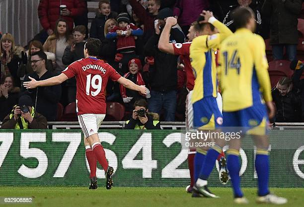 Middlesbrough's English midfielder Stewart Downing celebrates scoring his team's first goal during the English FA cup fourth round football match...