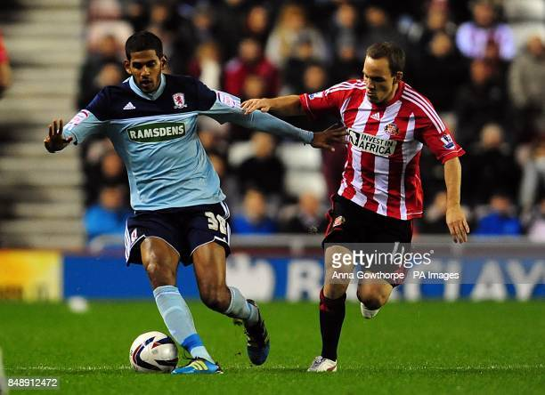Middlesbrough's Faris Haroun and Sunderland's David Vaughan battle for the ball