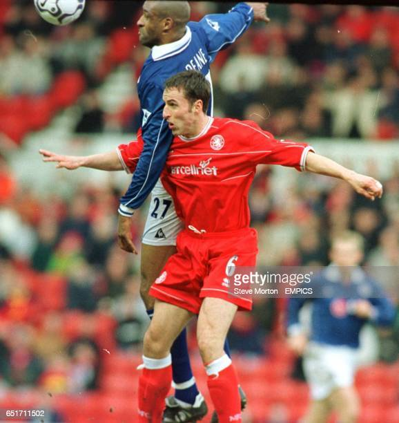 Middlesbrough's Gareth Southgate jumps in the air for the ball with Leicester City's Brian Deane