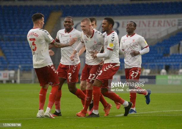 Middlesbrough's George Saville celebrates scoring his side's first goal with teammates during the Sky Bet Championship match between Cardiff City and...