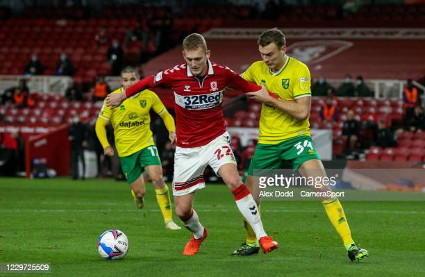 Middlesbrough's George Saville shields the ball from Norwich City's Ben Gibson during the Sky Bet Championship match between Middlesbrough and...