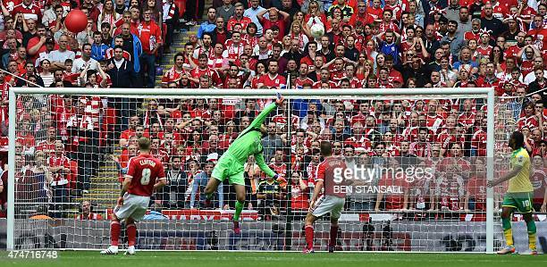 Middlesbrough's Greek goalkeeper Dimitrios Konstantopoulos dives as a shot from Norwich City's English midfielder Bradley Johnson hits the crossbar...