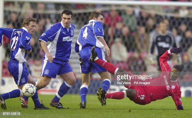 Middlesbrough's Hamilton Ricard is brought down by Everton defenders Scot Gemmill David Unsworth and Alan Stubbsduring their FA Barclaycard...