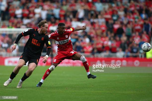 Middlesbrough's Isaiah Jones breaks away from Blackpool's Josh Bowler during the Sky Bet Championship match between Middlesbrough and Blackpool at...