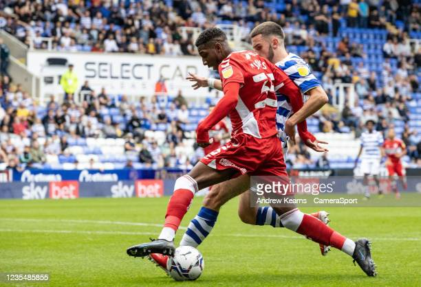 Middlesbrough's Isaiah Jones competing with Reading United's Dejan Tetek during the Sky Bet Championship match between Reading and Middlesbrough at...