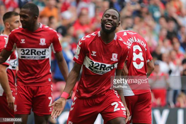 Middlesbrough's James Léa Siliki celebrates Middlesbrough's Marcus Tavernier during the Sky Bet Championship match between Middlesbrough and...