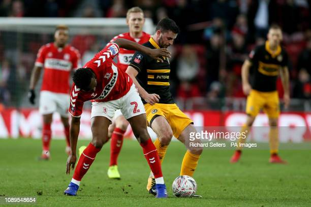 Middlesbrough's John Obi Mikel and Newport County's Padraig Amond during the FA Cup fourth round match at Riverside Stadium Middlesbrough