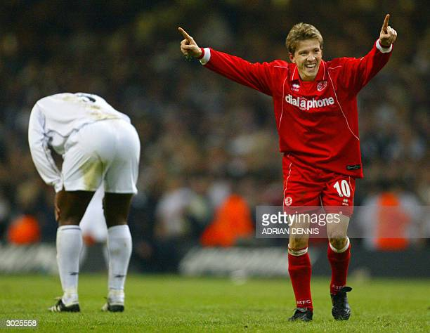 Middlesbrough's Juninho celebrates his team's win as Bolton's Bruno N'Gotty hangs his head after the Carling Cup Final football match 29 February...
