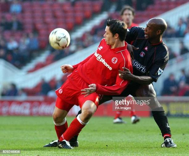 Middlesbrough's Malcom Christie holds off Richard Rufus of Charlton during the Barclaycard Premiership match at The Riverside Stadium Middlesbrough...