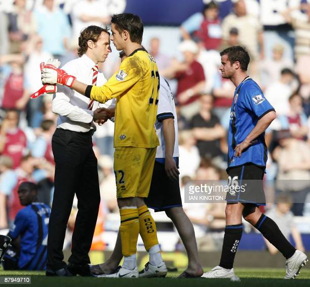 Middlesbrough's Manager Gareth Southgate shakes hands with Middlesbrough's Australian goalkeeper Brad Jones after Middlesbrough are relegated after...