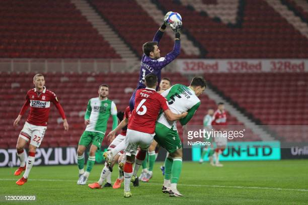 Middlesbrough's Marcus Bettinelli claims a high ball under pressure from Millwall's Jake Cooper during the Sky Bet Championship match between...