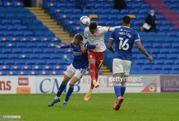 Middlesbrough's Marcus Tavernier beats Cardiff City's Joel Bagan to the header and sees his efforts hit the bar during the Sky Bet Championship match...