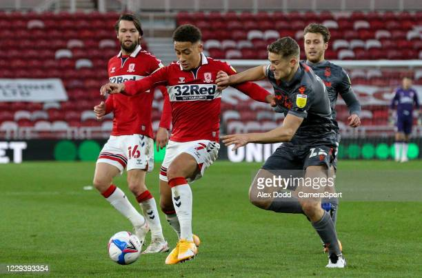 Middlesbrough's Marcus Tavernier shields the ball from Nottingham Forest's Ryan Yates during the Sky Bet Championship match between Middlesbrough and...