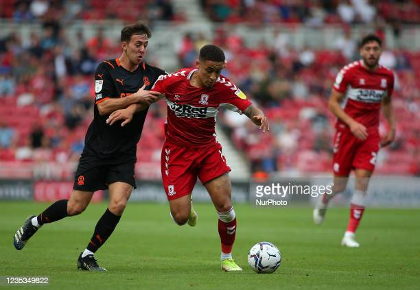 Middlesbrough's Marcus Tavernier takes on a Blackpool defender during the Sky Bet Championship match between Middlesbrough and Blackpool at the...