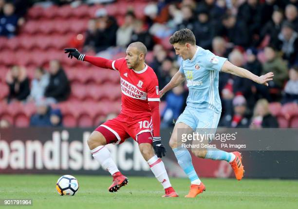 Middlesbrough's Martin Braithwaite and Sunderland's Billy Jones battle for the ball during the FA Cup third round match at the Riverside Stadium...