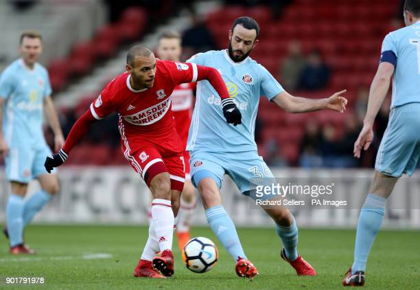 Middlesbrough's Martin Braithwaite and Sunderland's Marc Wilson battle for the ball during the FA Cup third round match at the Riverside Stadium...