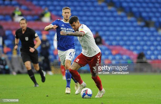 Middlesbrough's Marvin Johnson takes on Cardiff City's Will Vaulks during the Sky Bet Championship match between Cardiff City and Middlesbrough at...