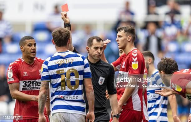 Middlesbrough's Matt Crooks is shown a red card by referee Peter Bankes during the Sky Bet Championship match between Reading and Middlesbrough at...