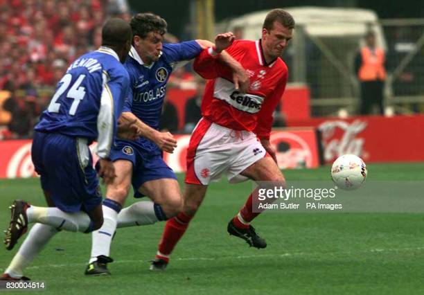 Middlesbrough's Neil Maddison of holds off Chelsea's Mark Hughes and Eddie Newton during the Coca Cola Cup Final at Wembley today Photo by Adam...