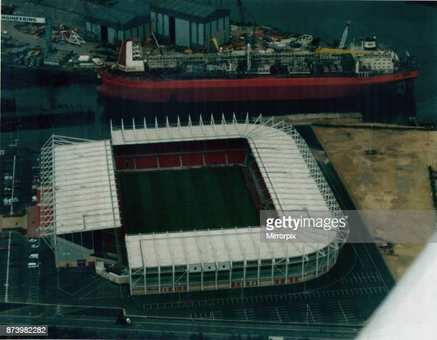 Middlesbrough's new Riverside Stadium is ready, August 1995. The giant ship North Sea Producer seen here being converted into an FPSO vessel is...