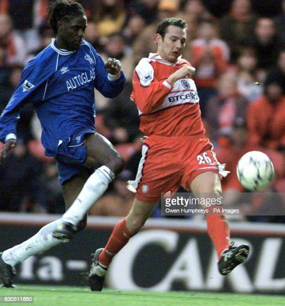 LEAGUE Middlesbrough's Noel Whelan shoots as Chelsea's Mario Melchiot moves in during their FA Premiership football match at The Riverside Stadium in...