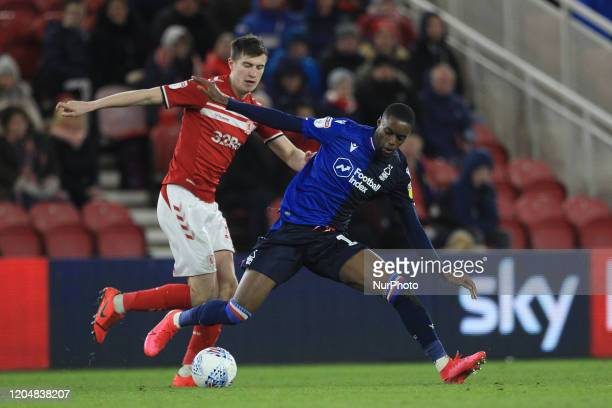 Middlesbrough's Paddy McNair battles with Alfa Semedo of Nottingham Forest during the Sky Bet Championship match between Middlesbrough and Nottingham...