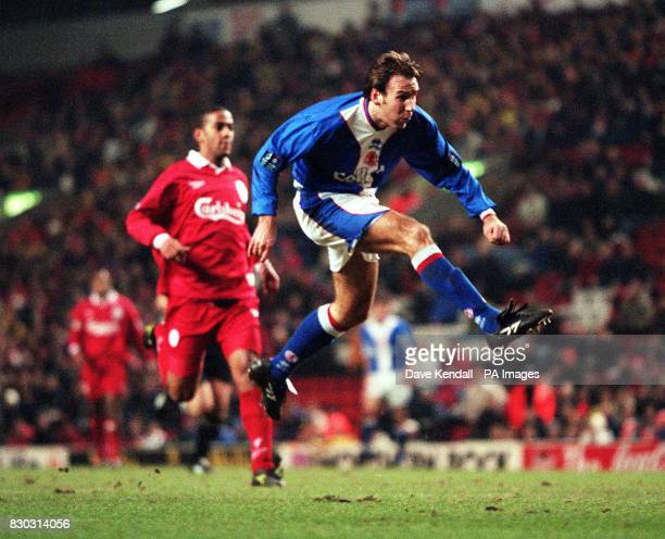 Middlesbrough's Paul Merson scores the first goal at Anfield as he fires home past David James in tonight's Coca Cola Cup semi final Pic Dave...