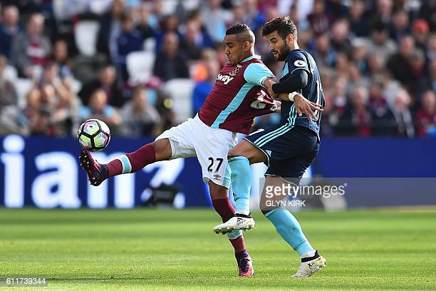 Middlesbrough's Spanish defender Antonio Barragan challenges West Ham United's French midfielder Dimitri Payet during the English Premier League...