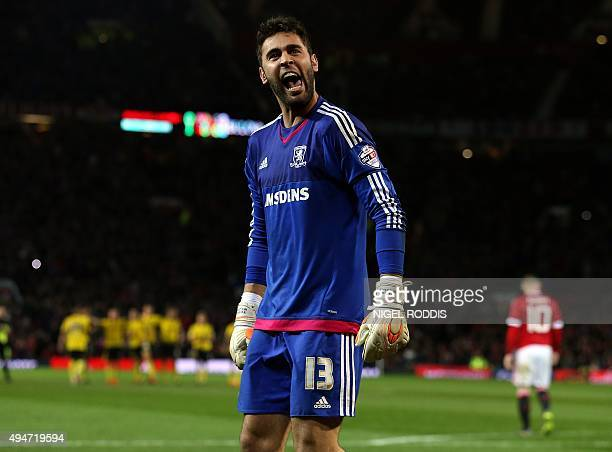 Middlesbrough's Spanish goalkeeper Tomas Mejias celebrates after saving Wayne Rooney's penalty in the shoot-out during the English League Cup fourth...