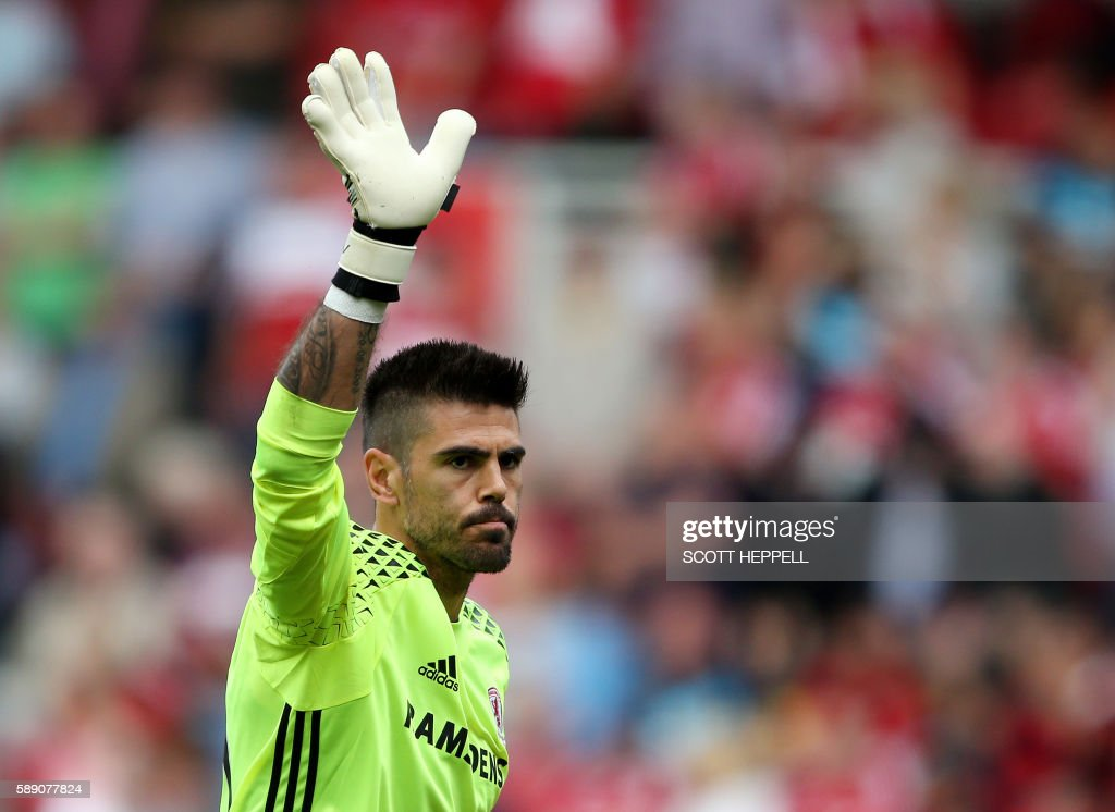 Middlesbrough's Spanish goalkeeper Victor Valdes gestures to supporters during the English Premier League football match between Middlesbrough and Stoke City at Riverside Stadium in Middlesbrough, northeast England on August 13, 2016. / AFP PHOTO / SCOTT HEPPELL / RESTRICTED TO EDITORIAL USE. No use with unauthorized audio, video, data, fixture lists, club/league logos or 'live' services. Online in-match use limited to 75 images, no video emulation. No use in betting, games or single club/league/player publications. /