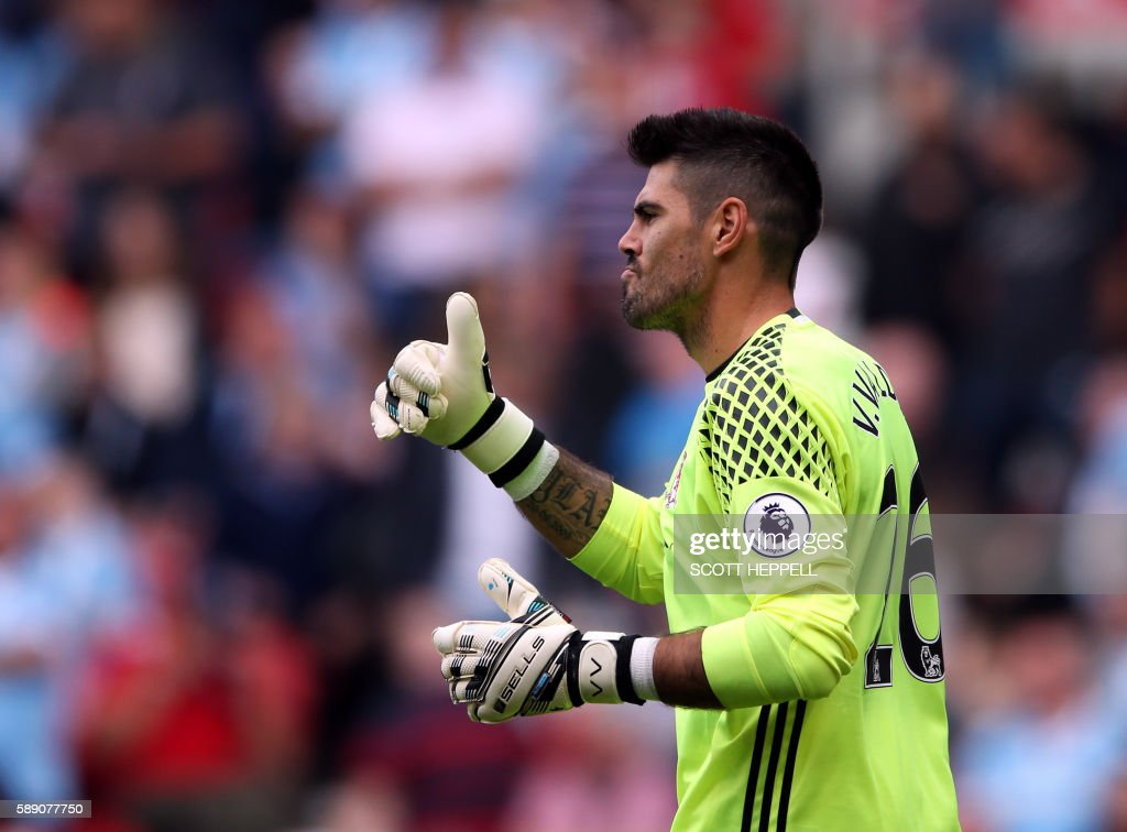 Middlesbrough's Spanish goalkeeper Victor Valdes gestures to his team-mates during the English Premier League football match between Middlesbrough and Stoke City at Riverside Stadium in Middlesbrough, northeast England on August 13, 2016. / AFP PHOTO / SCOTT HEPPELL / RESTRICTED TO EDITORIAL USE. No use with unauthorized audio, video, data, fixture lists, club/league logos or 'live' services. Online in-match use limited to 75 images, no video emulation. No use in betting, games or single club/league/player publications. /