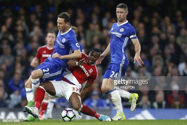 Middlesbrough's Spanish midfielder Adama Traoré tackles Chelsea's Serbian midfielder Nemanja Matic during the English Premier League football match...