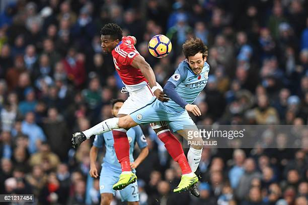 TOPSHOT Middlesbrough's Spanish midfielder Adama Traore and Manchester City's Spanish midfielder David Silva go up for a header during the English...