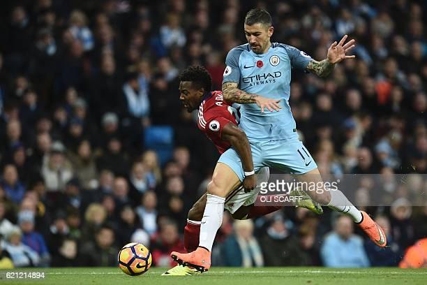 Middlesbrough's Spanish midfielder Adama Traore challenges Manchester City's Serbian defender Aleksandar Kolarov during the English Premier League...