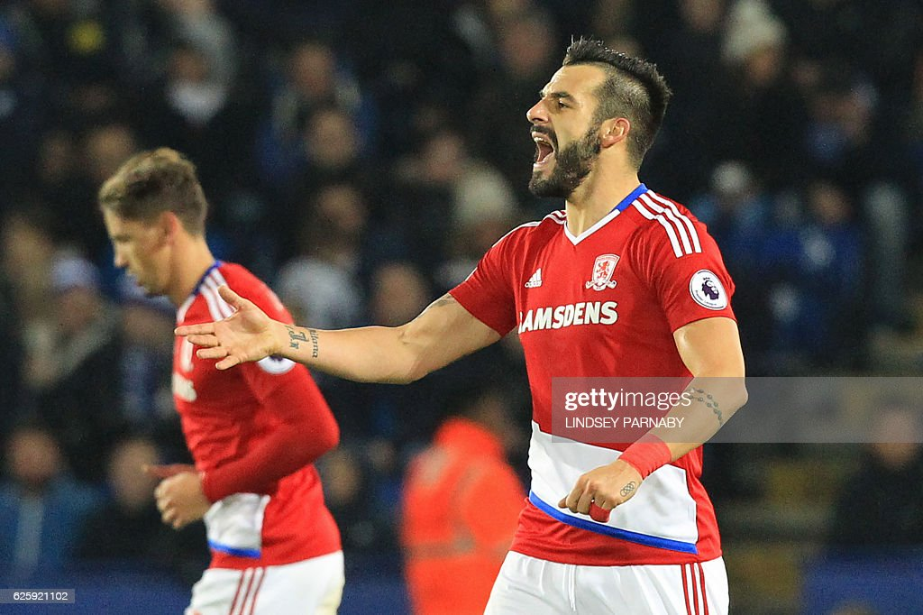 Middlesbrough's Spanish striker Alvaro Negredo celebrates after scoring his second goal during the English Premier League football match between Leicester City and Middlesbrough at King Power Stadium in Leicester, central England on November 26, 2016. / AFP / Lindsey PARNABY / RESTRICTED TO EDITORIAL USE. No use with unauthorized audio, video, data, fixture lists, club/league logos or 'live' services. Online in-match use limited to 75 images, no video emulation. No use in betting, games or single club/league/player publications. /