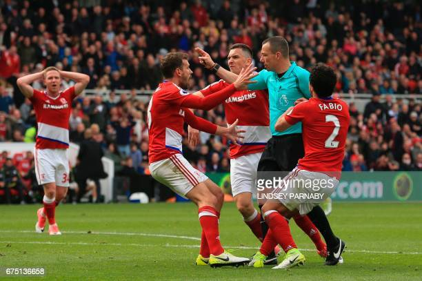Middlesbrough's Uruguayan striker Christian Stuani argues with the referee about awarding Manchester City a penalty during the English Premier League...