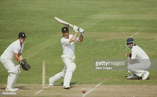 Middlesex batsman Mike Brearley cuts the ball towards the boundary watched by Warwickshire wicketkeeper Geoff Humpage during his second innings...