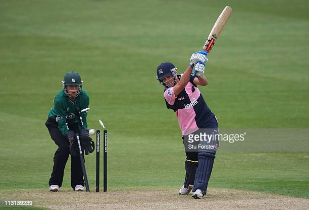 Middlesex batsman Tom Scollay is bowled as wicketkeeper Ben Cox looks on during the Clydesdale Bank 40 match between Worcestershire Royals and...