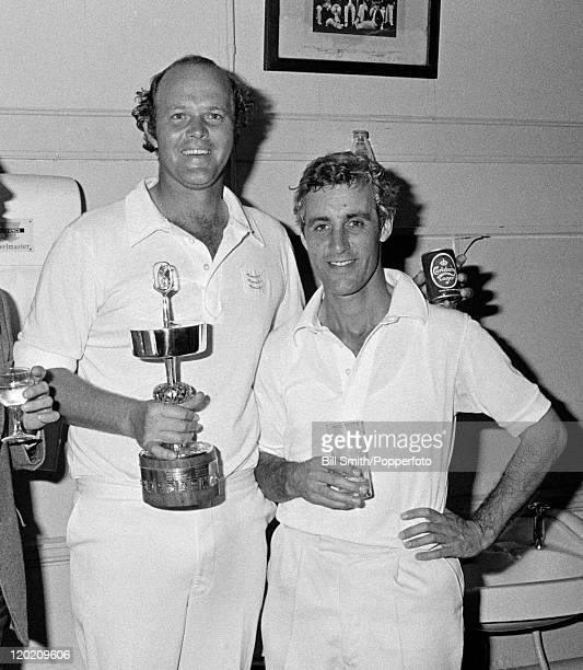 Middlesex captain Mike Brearley in the dressing room with team-mate Vintcent van der Bijl who is holding the trophy after their victory over Surrey...