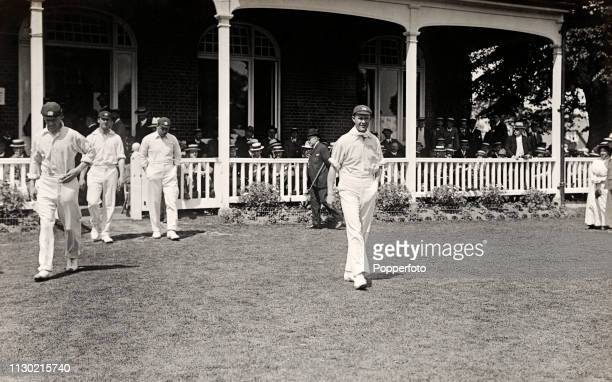 Middlesex captain Pelham Warner leading his team onto the field during their County Championship match again Kent at the St Lawrence Ground in...
