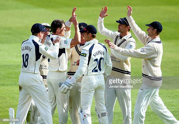 Middlesex celebrate with James Harris of Middlesex after he bowls out lbw Riki Wessels of Nottinghamshire during day one of the LV County...