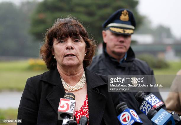 Middlesex County District Attorney Marian Ryan briefs the media as State Police Col. Christopher Mason looks after an armed stand off with police in...