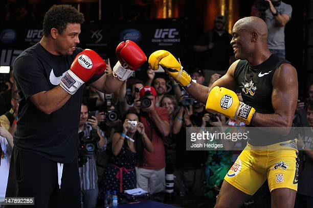 Middleweight Champion Anderson Silva spars with Brazilian soccer legend Ronaldo during the UFC 148 Open Workouts inside XS nightclub at the Encore on...