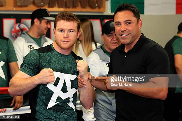 Middleweight champion Canelo Alvarez poses with Chairman and CEO of Golden Boy Productions Oscar De La Hoya during a media workout at the House of...