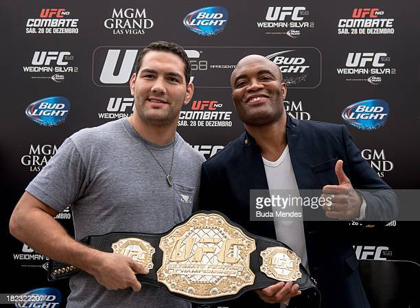 Middleweight champion Chris Weidman and former middleweight champion Anderson Silva face off for the media during the UFC 168: Weidman v SIlva 2...