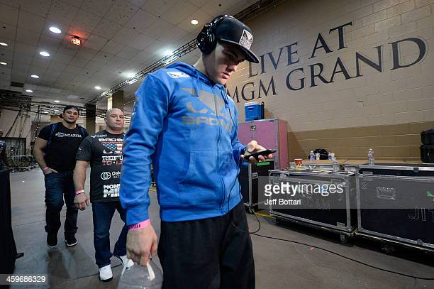 Middleweight Champion Chris Weidman arrives at the arena prior to his middleweight championship bout against Anderson Silva during the UFC 168 event...