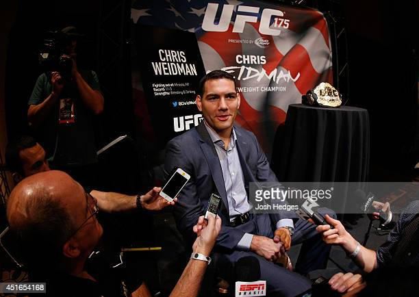Middleweight champion Chris Weidman interacts with media during the UFC Ultimate Media Day at the Mandalay Bay Resort and Casino on July 3, 2014 in...
