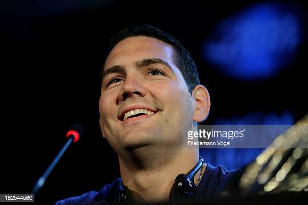 UFC middleweight champion Chris Weidman poses for the media during the UFC 168 Weidman v SIlva 2 press conference at the Hilton Hotel on September 30...