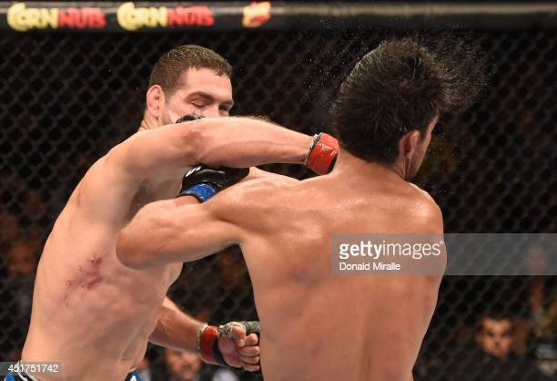 Middleweight champion Chris Weidman punches Lyoto Machida in their UFC middleweight championship fight at UFC 175 inside the Mandalay Bay Events...